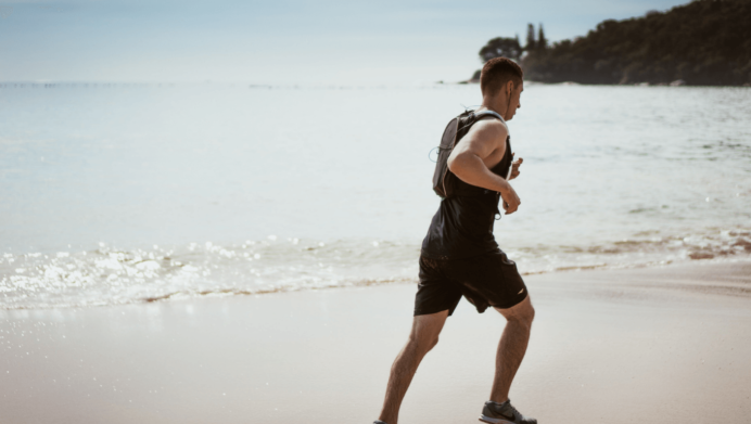image of a man exercising near the ocean